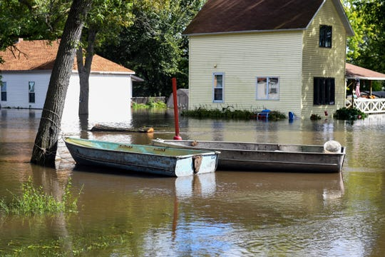 Residents of Dell Rapids, SD, deal with massive flooding after severe storms in the area on Friday, September 13, 2019.