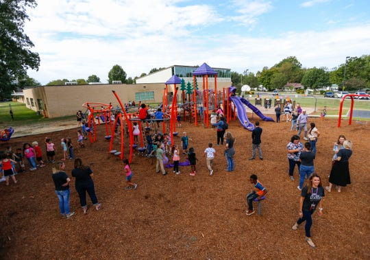 Weller Elementary School students play on the school's new playground on Friday, Sept. 13, 2019 after a ribbon cutting ceremony.
