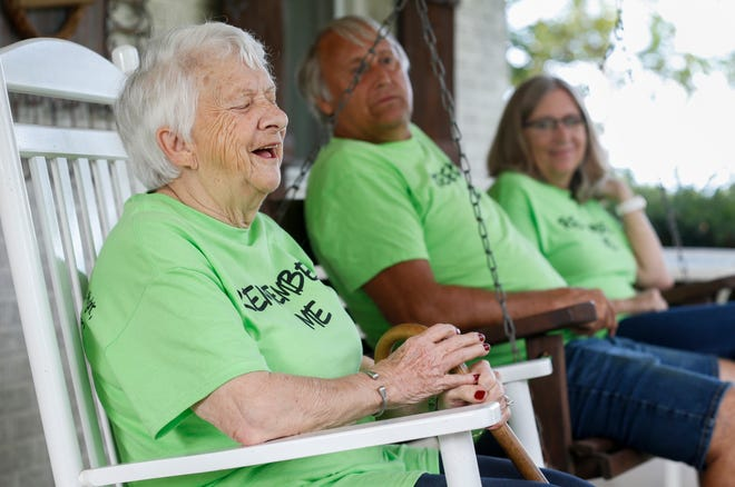 Loretta Essary laughs as she talks about her experience with Alzheimer's disease at the family's home in Highlandville, Mo., on Friday, Sep. 13, 2019.
