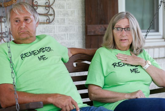 Alice Seaton talks about supporting her husband Mark and parents who all have Alzheimer's disease at the family's home in Highlandville, Mo., on Friday, Sep. 13, 2019.