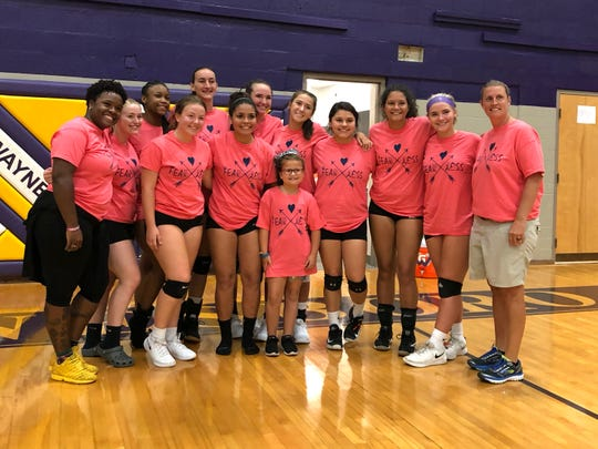 The Waynesboro volleyball team following its win over Stuarts Draft Thursday. In the middle is 8-year-old Aida Aleshire who has Type 1 diabetes and sat on the bench with the Little Giants during the match.
