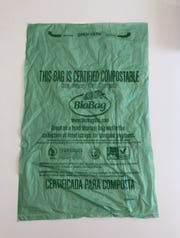 Volunteers hand out these free, compostable bags to people interested in participating in the composting initiative.