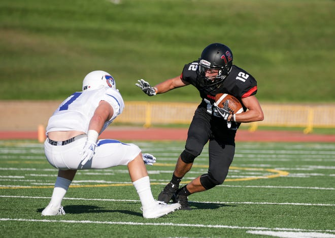 SCSU receiver Tanner Tiege moves past a University of Mary defender Thursday, Sept. 5, 2019, at the University of Mary.