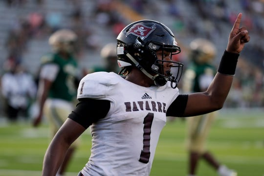 Navarre quarterback Marlon Courtney III celebrates a touchdown run as the Raiders fell 35-20 to Lincoln at Gene Cox Stadium on Thursday, Sept. 12, 2019.