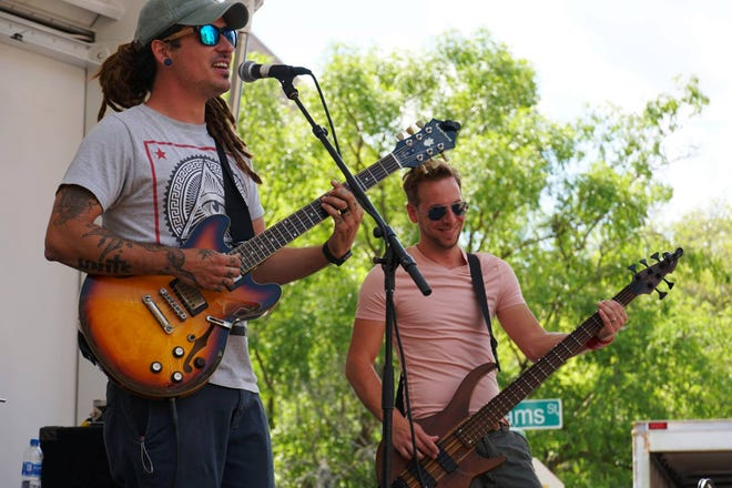 Travis Green, left, performs with Sway Jah Vu during a downtown event.