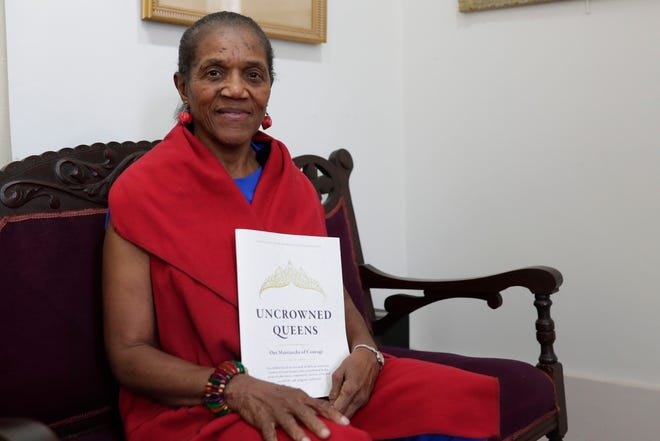 """Althemese Barnes, , founding director of the John G. Riley Center, poses for a photo with her new book """"Uncrowned Queens"""" Friday, Sept. 13, 2019."""