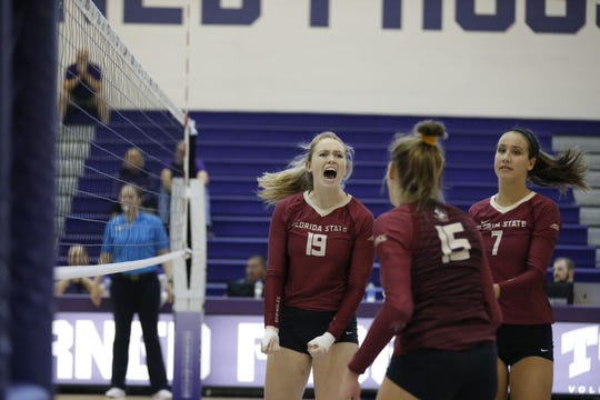 Florida State volleyball player Madison Sullivan (No. 19) reacts to a play with teammates Lily Tessier (No. 7) and Payton Caffrey (No. 15) during a match at TCU in Fort Worth, Texas, during the weekend of Sept. 6-8, 2019.