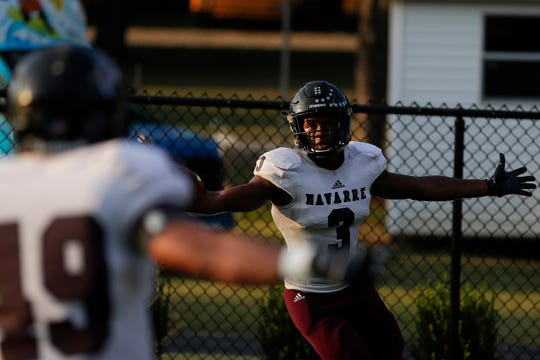 Navarre receiver Xayvion Thomas celebrates after a 39-yard touchdown catch, but the Raiders fell 35-20 to Lincoln at Gene Cox Stadium on Thursday, Sept. 12, 2019.