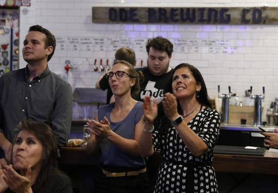 Dawn Vigil and Beto O'Rourke supporters cheer during Thursday night's debate.