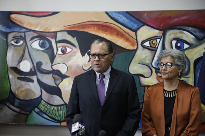 State Sen. José Rodríguez stands alongside his wife, Carmen, as he announces he will not seek reelection to the Texas Senate and will retire.