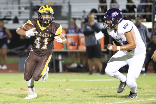 Golden West's Eric Castillo runs against Madera South in a non-league High School Football game at Visalia Community Stadium on Thursday, Sept 12, 2019.