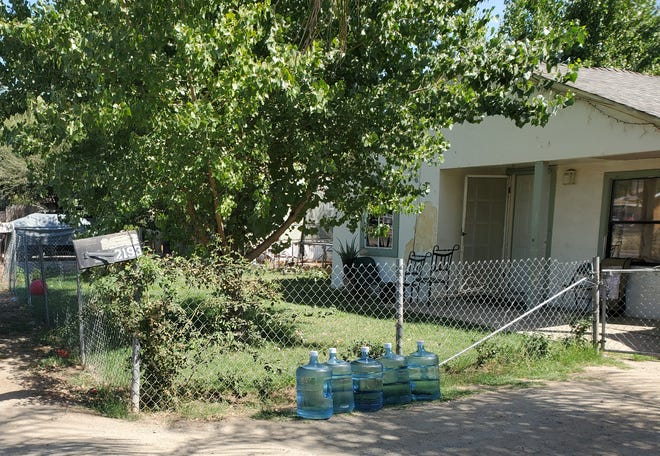 Empty water bottles sit outside a home in Tooleville. The rural Tulare County community has struggled for decades with contaminated drinking water. Exeter City Council voted on Tuesday to nix discussions on a proposal that would connect Tuleville to the municipal water supply.