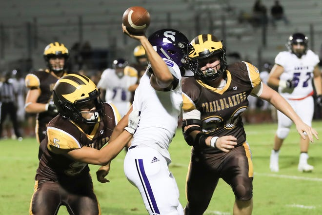 The Golden West defense rallies to the football against Madera South in a non-league High School Football game at Visalia Community Stadium on Thursday, Sept 12, 2019.