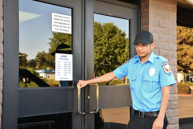 Guard Mario Cortez turns away customers at the Visalia DMV on Friday, Sept. 13. The office was shut down Thursday after mold was discovered in the building.