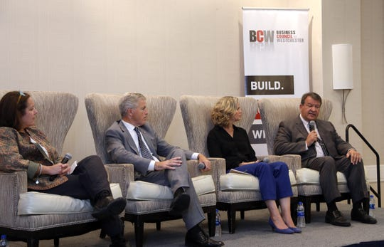 Journalist Lisa Foderaro, left, moderates a discussion with Suffolk County Executive Steve Bellone, Nassau County Executive Laura Curran and Westchester County Executive George Latimer on the future of New York suburbs at a Business Council of Westchester event Sept. 13, 2019 at Crowne Plaza in White Plains.