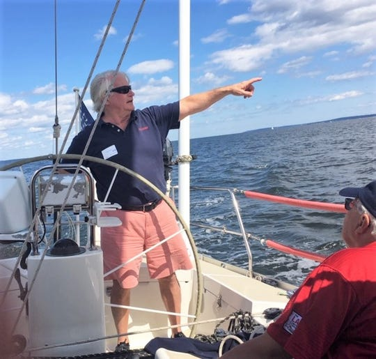 Dick York talks to Sailing Heals guests aboard his sailboat on Long Sound Sept. 7, 2019.