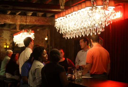 Chandeliers illuminate two communal tables at Torbert Street Social.