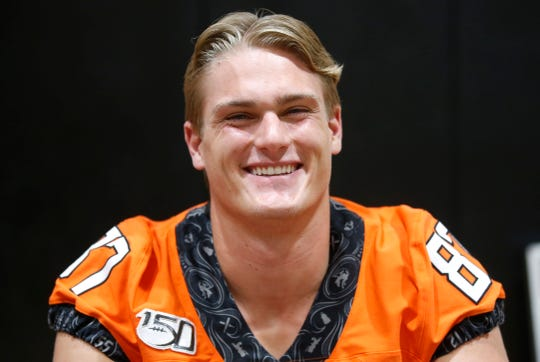 Oklahoma State's Logan Carter is pictured during an NCAA college football media day in Stillwater Okla., Saturday, Aug. 3, 2019. (AP Photo/Sue Ogrocki)