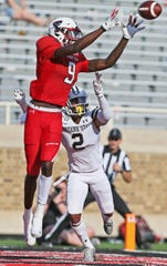 Texas Tech's T.J. Vasher (9) attempts to catch the ball over Montana State's Tyrel Thomas during the second half of an NCAA college football game Saturday, Aug. 31, 2019, in Lubbock, Texas. (Sam Grenadier/Lubbock Avalanche-Journal via AP)