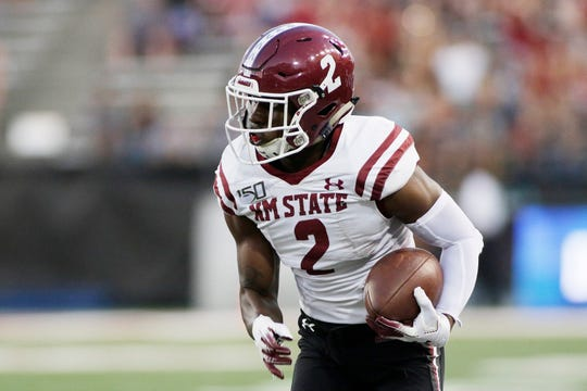 New Mexico State wide receiver OJ Clark (2) runs with the ball during the first half of an NCAA college football game against Washington State in Pullman, Wash., Saturday, Aug. 31, 2019. (AP Photo/Young Kwak)