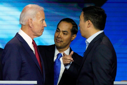 From left, Democratic presidential candidates Joe Biden, Julian Castro and Andrew Yang talk on Sept. 12, 2019, after the debate in Houston.