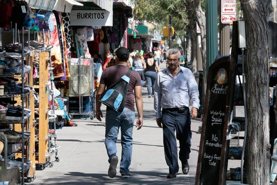 Shoppers walk along El Paso Street in downtown El Paso just adjacent to the Segundo Barrio.
