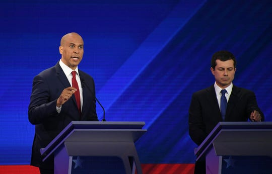 Democratic presidential hopefuls New Jersey Senator Cory Booker, left, and Mayor of South Bend, Indiana, Pete Buttigieg speak during the third Democratic primary debate of the 2020 presidential campaign season hosted by ABC News in partnership with Univision at Texas Southern University in Houston, Texas on Sept. 12, 2019.