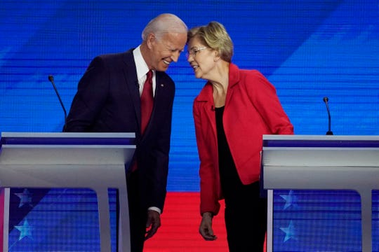 Democratic presidential candidates former Vice President Joe Biden, left and Sen. Elizabeth Warren, D-Mass., talk Thursday, Sept. 12, 2019, during a Democratic presidential primary debate hosted by ABC at Texas Southern University in Houston.