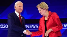 Democratic presidential hopefuls Massachusetts Senator Elizabeth Warren and Former Vice President Joe Biden shake hands as they arrive onstage for the third Democratic primary debate of the 2020 presidential campaign season hosted by ABC News in partnership with Univision at Texas Southern University in Houston, Texas on Sept.12, 2019.