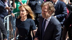 Felicity Huffman and her husband, actor William H Macy, arrive at the federal courthouse for her sentencing in the college admission scandal in Boston, Sept. 13, 2019.