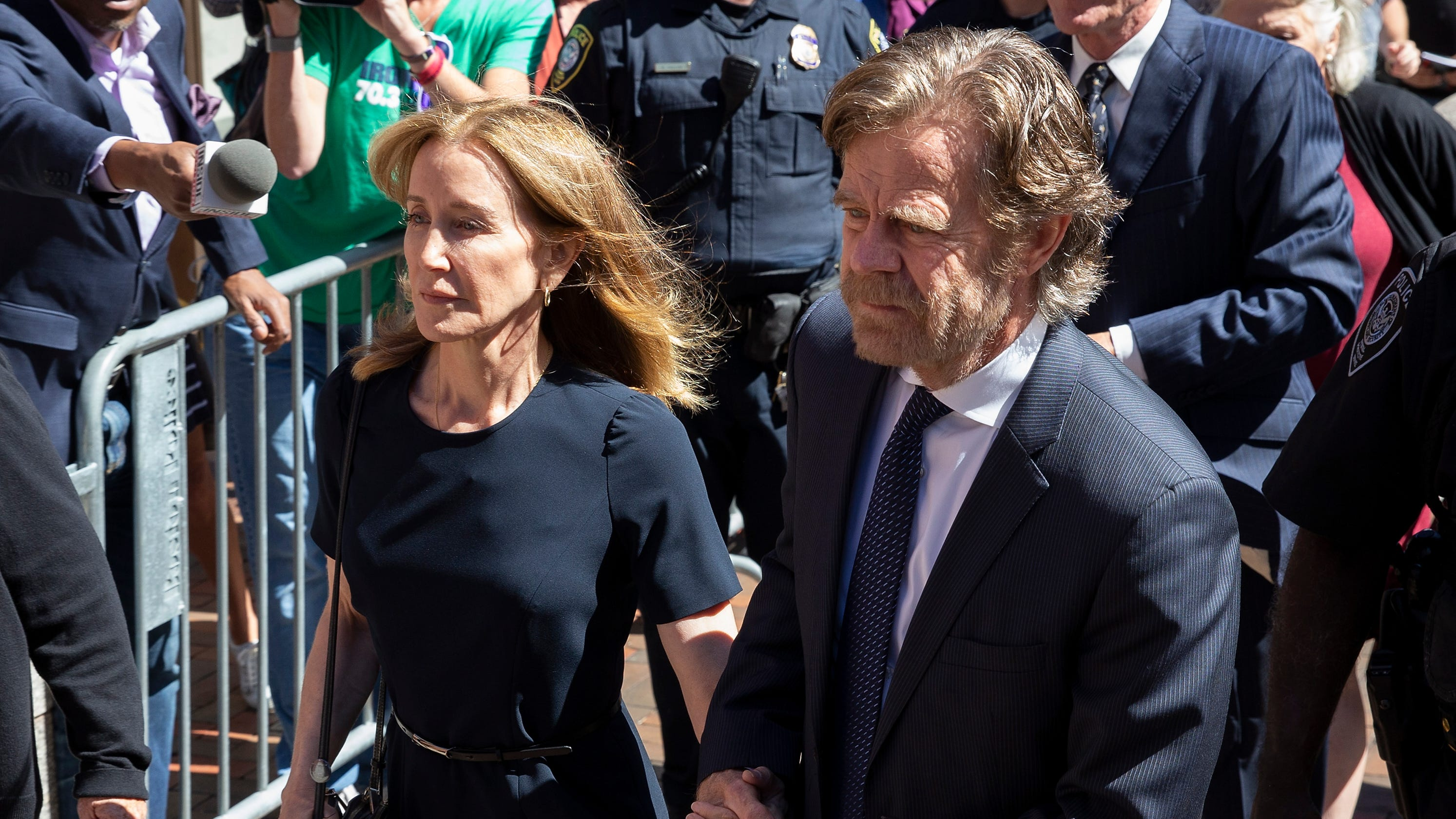 Felicity Huffman reports to prison to begin serving time in college admissions scandal