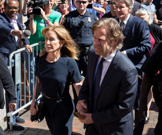 Felicity Huffman and her husband, actor William H. Macy, arrive at the federal courthouse for her sentencing in the college admission scandal in Boston, Sept. 13, 2019.