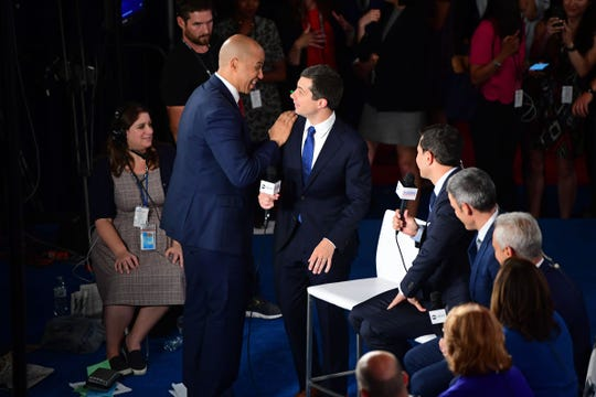 Democratic presidential hopeful New Jersey Senator Cory Booker, left, greets Mayor of South Bend, Indiana, Pete Buttigieg at the Spin Room after the third Democratic primary debate of the 2020 presidential campaign season hosted by ABC News in partnership with Univision at Texas Southern University in Houston, Texas on Sept. 12, 2019.