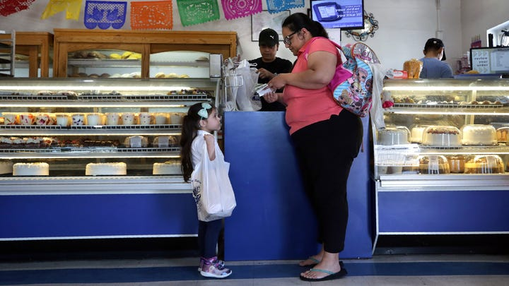 Vida Estrada shops at Bowie Bakery with her daughter Natalie Ulloa, 4, in the heart of the Segundo Barrio of El Paso,  Sept. 12, 2019.