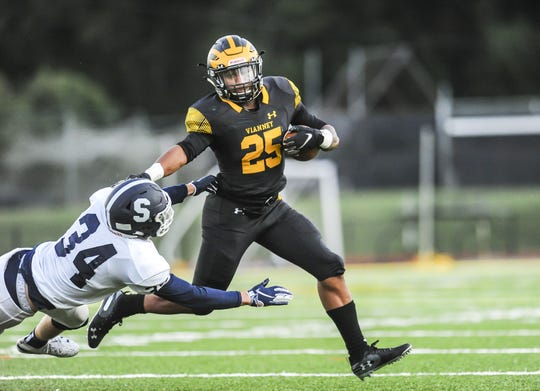 Kavon Chambers of St. John Vianney stiff-arms Matt Krellin of Middletown South in a game in Holmdel on Sept. 13, 2019.
