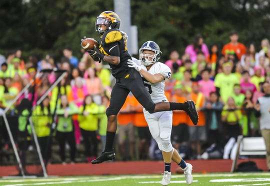 Jayden Bellamy of St. John Vianney hauls in a long pass in front of Matthew Grab of Middletown South in a game in Holmdel on Sept. 13, 2019.