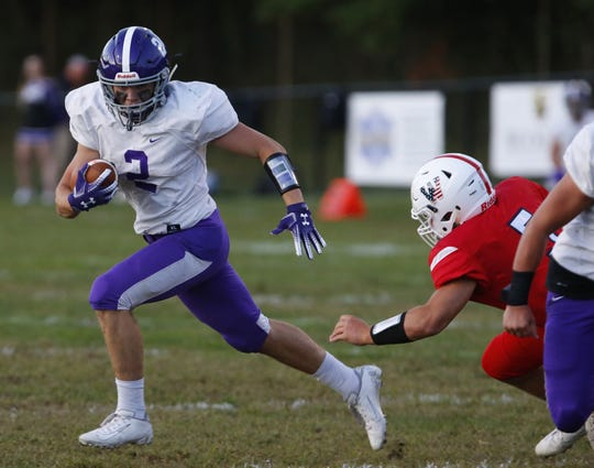 John Volker (2) of Rumson -Fair Haven rushes against  Wall Twp. during high school football game at Wall Twp. High School.Wall,NJ. Friday, September 13, 2019. Noah K. Murray-Correspondent/Asbury Park Press