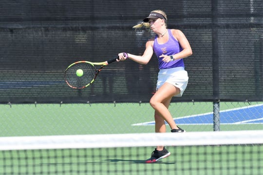Wylie's Carly Bontke hits a shot during the No. 2 girls singles match against Wichita Falls Rider on Saturday, Sept. 14, 2019. Bontke won 6-3, 6-2 as the Bulldogs won 17-2.