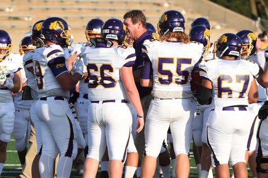Wylie coach Hugh Sandifer talks to his Bulldogs before facing Stephenville at Tarleton Memorial Stadium on Friday. The Bulldogs lost 34-0 and are 0-3 heading into the Southtown Showdown at Shotwell Stadium next week.