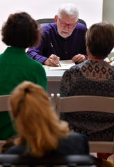 Watercolorist Gary Bukovnik demonstrates his technique Saturday while answering questions from the audience at Jody Klotz Fine Art.