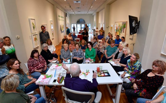 Watercolor and art enthusiasts listen to Gary Bukovnik talk about his work during a live demonstration at Jody Klotz Fine Art Saturday.