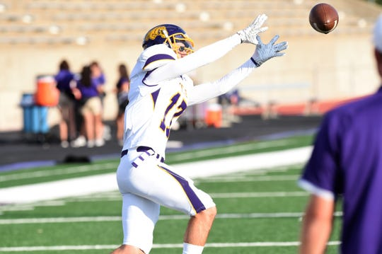 Wylie receiver Creed Cooper (17) reaches out to catch a pass during pregame warmups before facing Stephenville at Tarleton Memorial Stadium on Friday. Cooper caught two passes for 21 yards in the 34-0 loss.