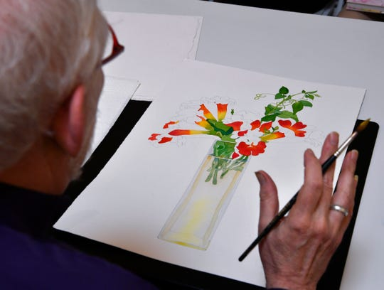 Gary Bukovnik answers a question during his watercolor demonstration at Jody Klotz Fine Art Saturday.