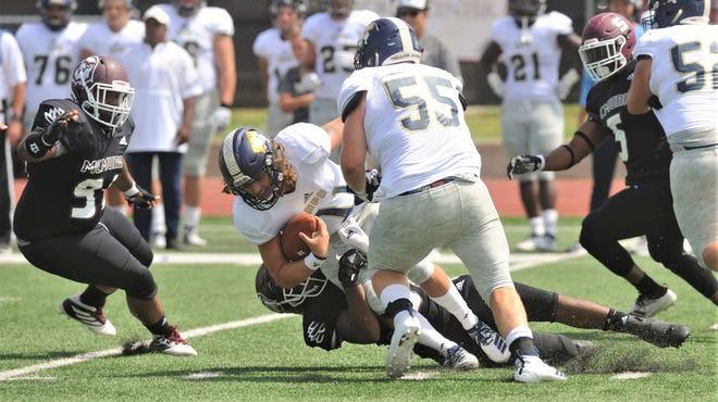 McMurry's Marc Jackson sacks Howard Payne quarterback Caleb Estes in the first quarter of the American Southwest Conference game Sept. 14 at Wilford Moore Stadium.