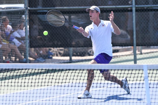Wylie's Carson Cole hits a shot during the No. 1 boys singles match against Wichita Falls Rider on Saturday, Sept. 14, 2019. Cole earned the 6-1, 6-1 victory as the Bulldogs won 17-2.