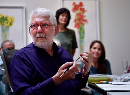 Watercolorist Gary Bukovnik describes Saturday how he prefers to paint color from memory rather than a photograph, describing nature as already perfect and something he couldn't hope to improve upon. Bukovnik was holding a demonstration of his technique at Jody Klotz Fine Art where his work is currently on exhibit.