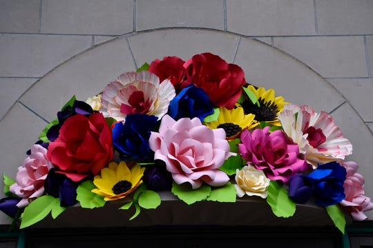 An oversized bouquet of artificial flowers crowns the doorway to Jody Klotz Fine Art Saturday. Watercolorist Gary Bukovnik held a demonstration of his technique inside the gallery where his work is currently on exhibit