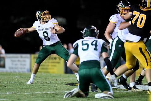 Christ School quarterback Navy Shuler throws a pass during the Greenies' game at Murphy High School on Sept. 13, 2019. The Greenies defeated the Bulldogs 27-7.