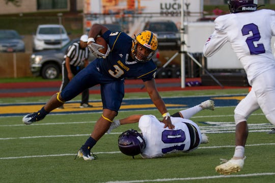 BCC's Tyshaan Williams escapes a tackle by Lakeview's Caleb Cary during the Spartans win on Friday.