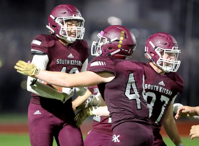 South Kitsap's  Da'Vi Guzman-Estrada (left) celebrates with teammates in the end zone after his touchdown in the second quarter against Rogers on Friday, September 13, 2019.